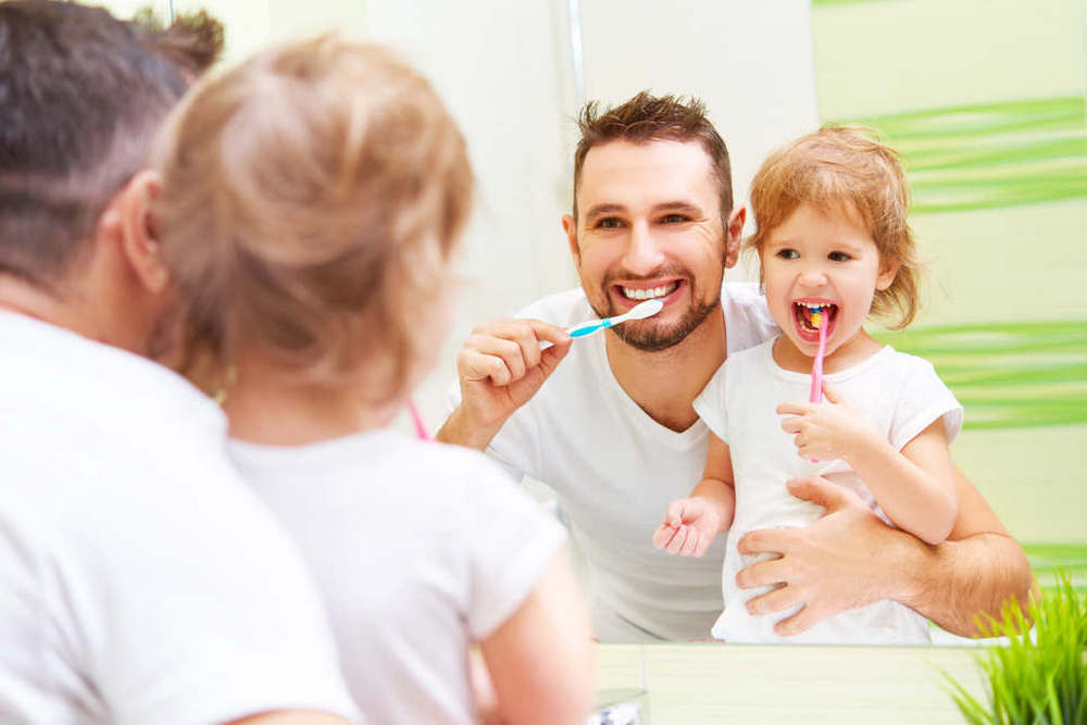 Happy,Family,Father,And,Daughter,Child,Girl,Brushing,Her,Teeth