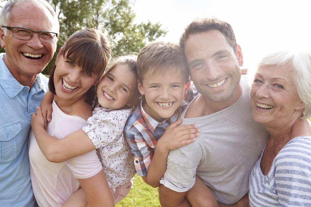 Multi,Generation,Family,Giving,Children,Piggybacks,Outdoors