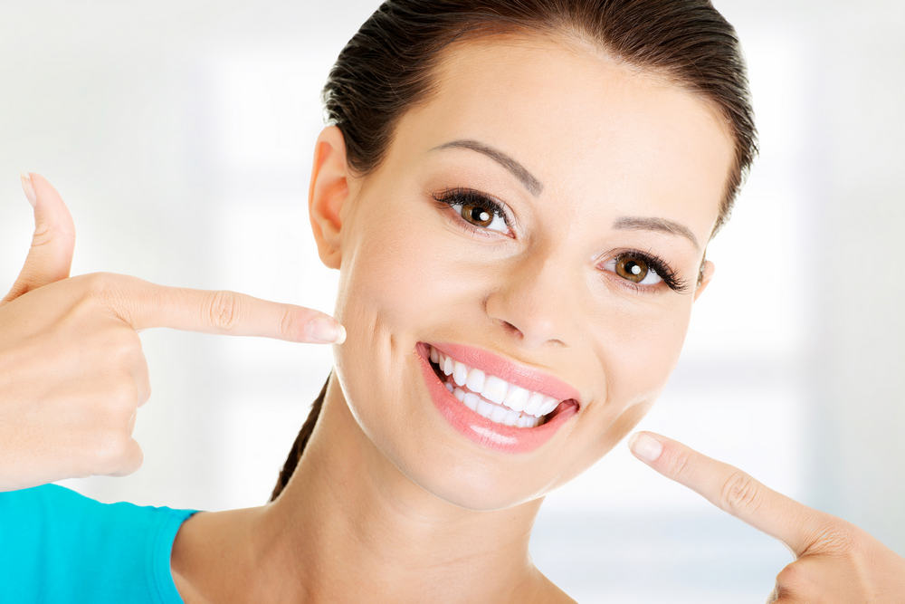 Woman,Showing,Her,Perfect,Straight,White,Teeth.