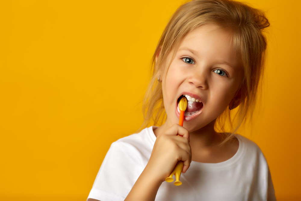 Girl brushing teeth - Preventing Tooth Decay in Children