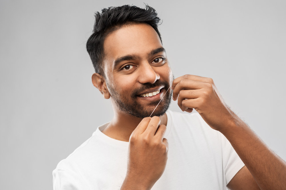 Man Flossing - The Ultimate Guide to Flossing
