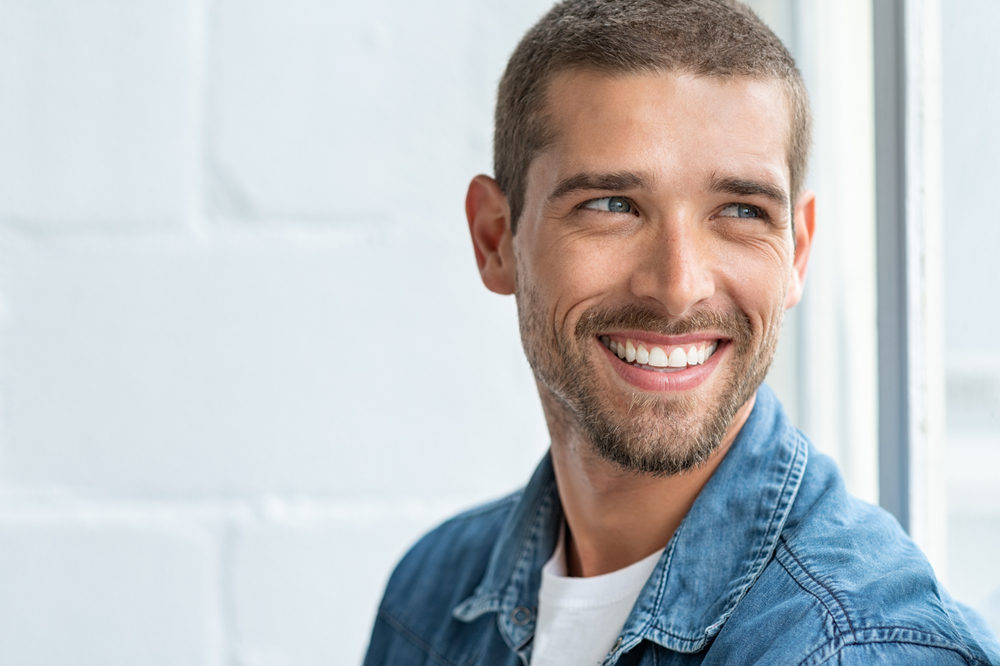 Man smiling - What You Can Do To Maintain Your Oral Health