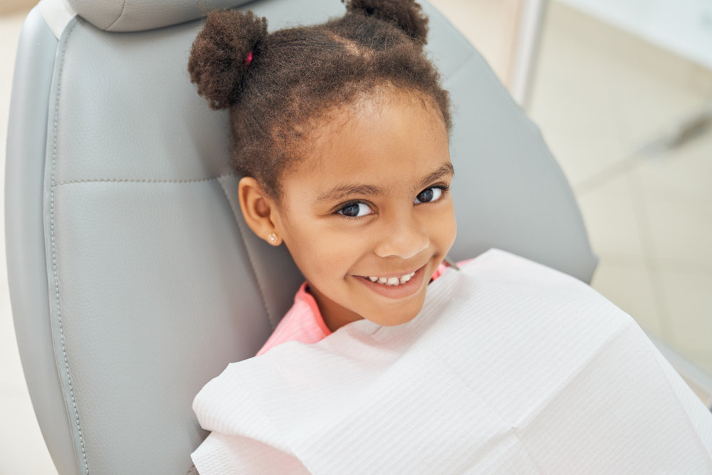 Girl at Dentist (Glossary of Kid-Friendly Dental Terms)