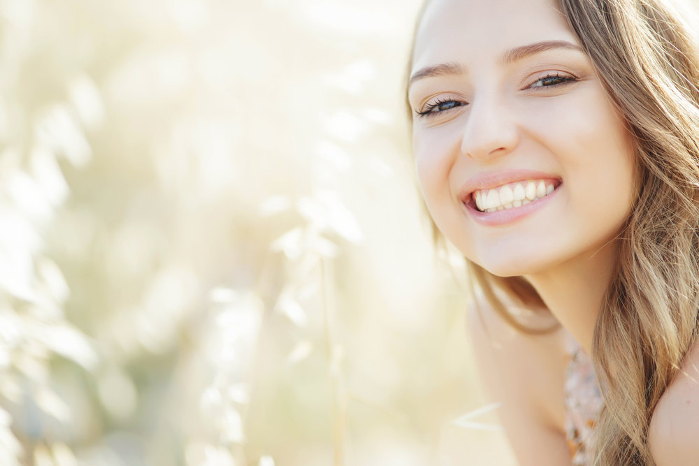 32. Woman smiling (All About Preventive Dental Care)